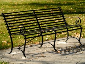 wrought iron bench in central park