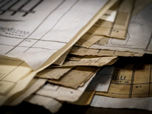 old blueprints in a pile
